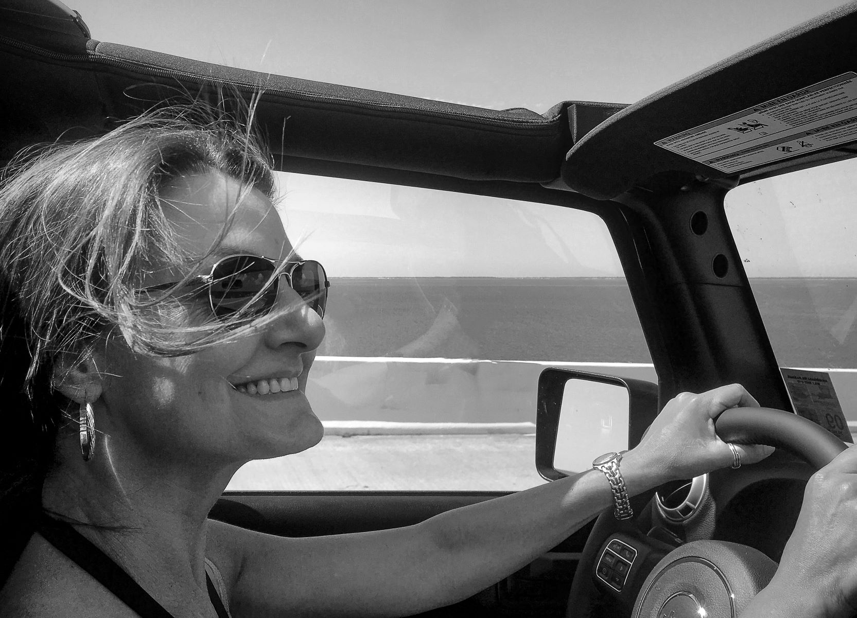 Carole Dupre driving her Jeep Wrangler