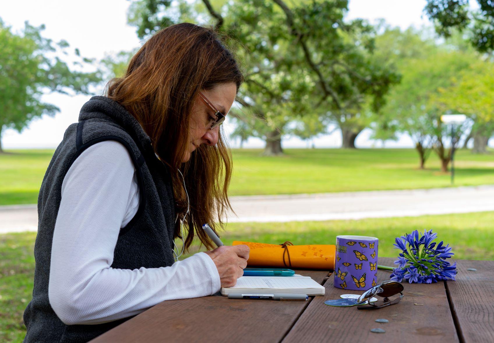 Carole reflecting through journaling.